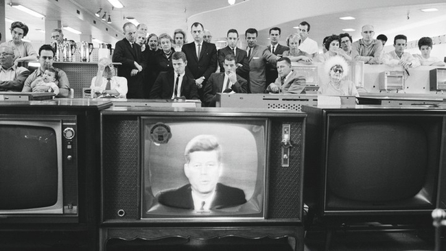 Customers in the electronics section of a department store watch as JFK addresses the nation, 22 October 1962