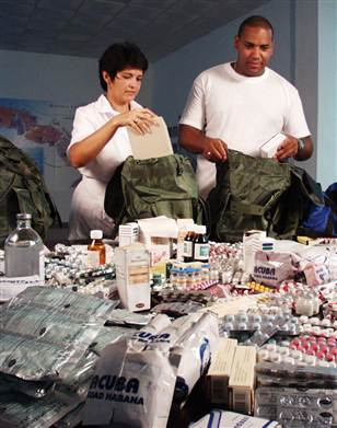Although it is unlikely they will be going anywhere, Havana doctors Luis Sauchay and Delvis Marta Fernandez prepare their knapsacks of emergency medical supplies for Katrina victims.