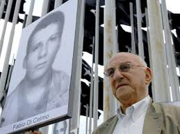 Giustino holds a photograph of his son Fabio at a vigil for justice for victims of terrorism in Havana