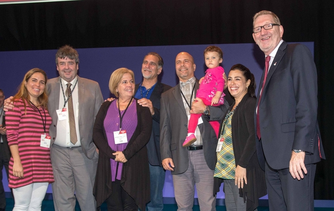 Rene and Gerardo on stage at Unite conference with their partners and daughters: photo Mark Thomas