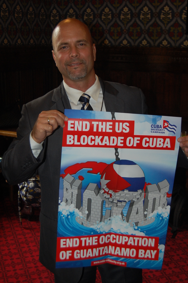 Gerardo with a copy of the CSC booklet and poster produced especially for the tour