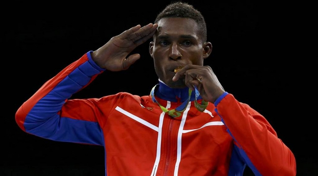 Julio César La Cruz on the podium with his gold medal in boxing, light heavyweight division, at Rio 2016