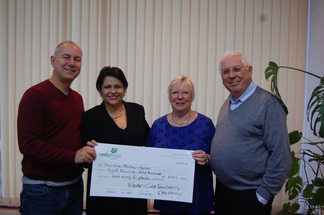 CSC director Rob Miller with executive members Carol and Bernard Regan delivering a cheque to Cuban ambassador HE Teresita Vicente