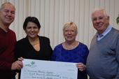 CSC director Rob Miller with executive members Carol and Bernard Regan delivering a cheque to Cuban ambassador HE Teresita Vicente