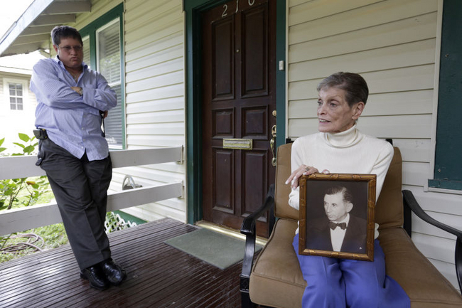 Sandra Lansky, right, holds a photo of her father, gangster and casino owner Meyer Lansky, during a visit with her son Gary Rapoport, left, at her Seminole Heights home. [JAMES BORCHUCK | Times]