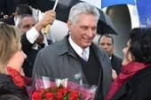 Cuban President Miguel Diaz-Canel is greeted at the airport by Cuban Ambassador Teresita Vicente