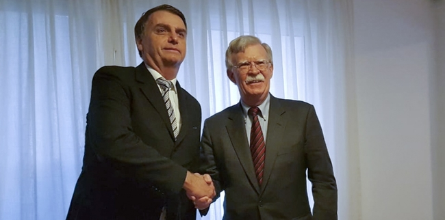 Brazil's President-elect Jair Bolsonaro and US national security adviser John Bolton shake hands ahead of the G20 summit in Argentina