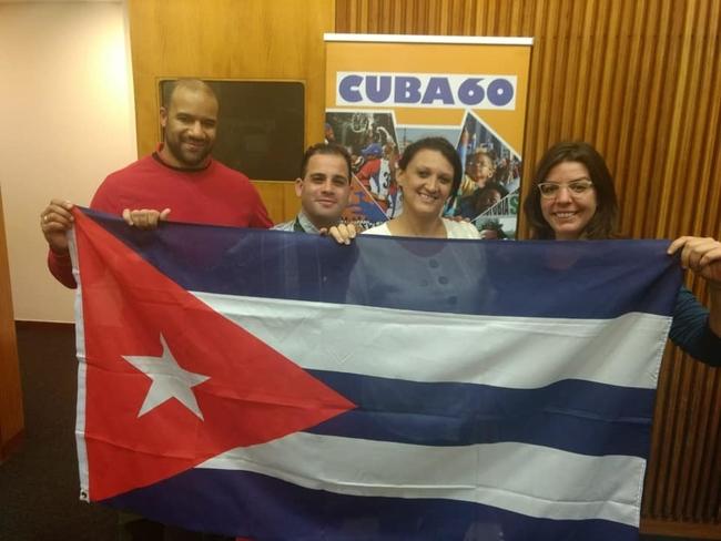 Yuniel Espinosa Reyes and Yelena Gomez Gomez, with CSC's Gordon Calliste and Yolanda Edo Figas