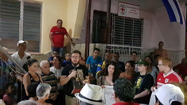 Logan Williams, Unite Wales, presenting material aid at Sancti Spiritus CDR