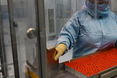 Technician Mayelin Mejias works with the 'Soberana 02' COVID-19 vaccine at the packaging processing plant of the Finlay Vaccine Institute in Havana, Cuba, Jan. 20, 2021. The director of the Finlay Ins