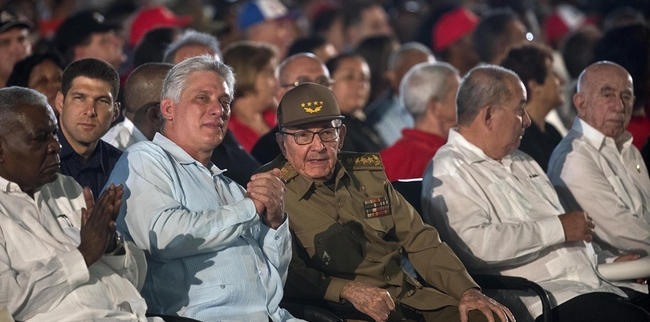 Cuba's former President Raul Castro (centre) and President Miguel Diaz-Canel (second left) attend an event celebrating Revolution Day in Santiago, Cuba