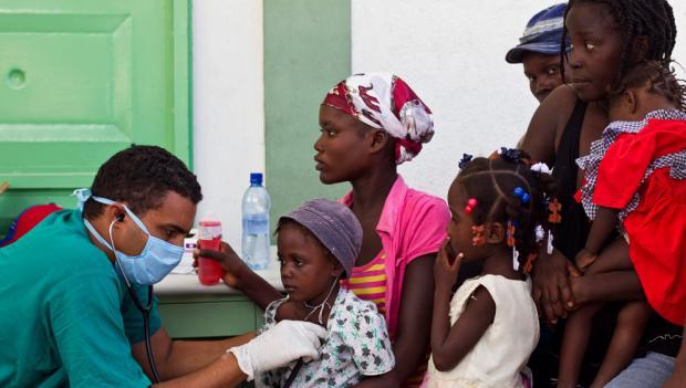 Cuban doctor treats cholera patients in a hospital in L'Estere, Haiti