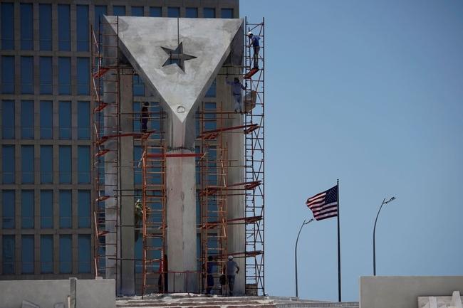 Men work in a monument in front of the U.S. Embassy in Havana, Cuba, May 25, 2021. REUTERS/Alexandre Meneghini