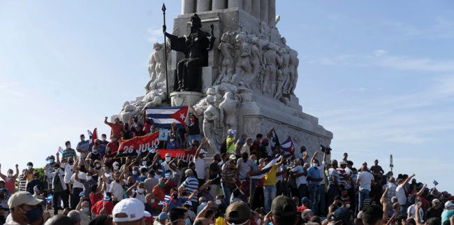 Pro-government supporters on 11 July. This image was used by multiple news agencies who captioned it as representing anti-government supporters